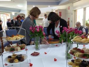 Margaret Miles and Janna Voloshin cut the cake.
